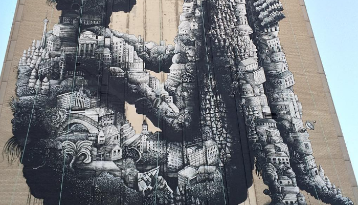 Street artist phlegm celebrates toronto with a massive 8 for Figure 8 mural